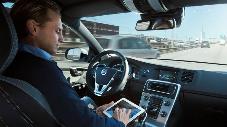 VOLVO AUTONOMOUS DRIVING - Person on Ipad While in Passenger Seat